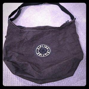 Kipling Brown messenger bag.